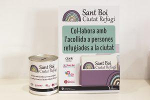 El material sobre la campanya dels refugiats que disposen els comerços adherits // Ajuntament de Sant Boi